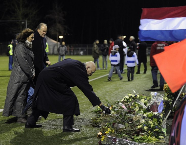 Michael van Praag, president of the Royal Dutch Football Association (KNVB), places flowers on the pitch of club Buitenboys to commemorate Richard Nieuwenhuizen (Reuters)