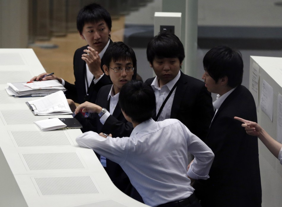 Asian investors wait and watch