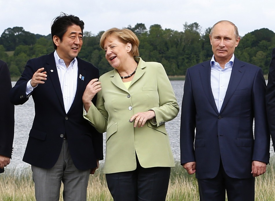 Japan's Prime Minister Shinzo Abe (L), German Chancellor Angela Merkel (C) and Russia's President Vladimir Putin take part in a group photo at the G8 Summit, at Lough Erne, near Enniskillen, in Northern Ireland June 18, 2013. (Photo: REUTERS)