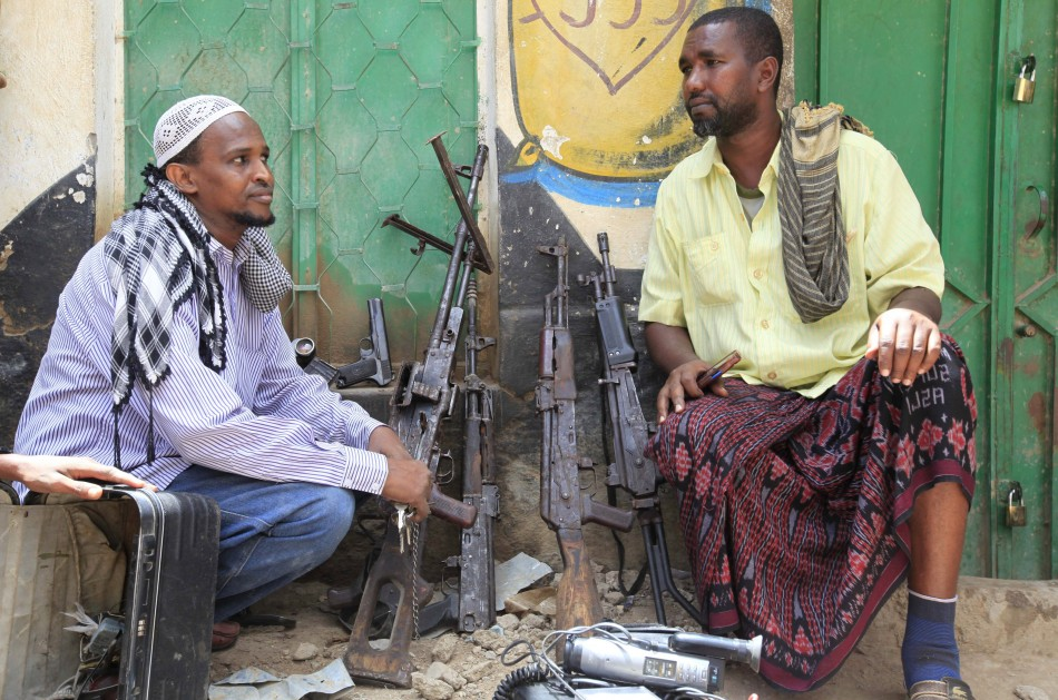 Suspected al-shabaab members and their weapons are paraded