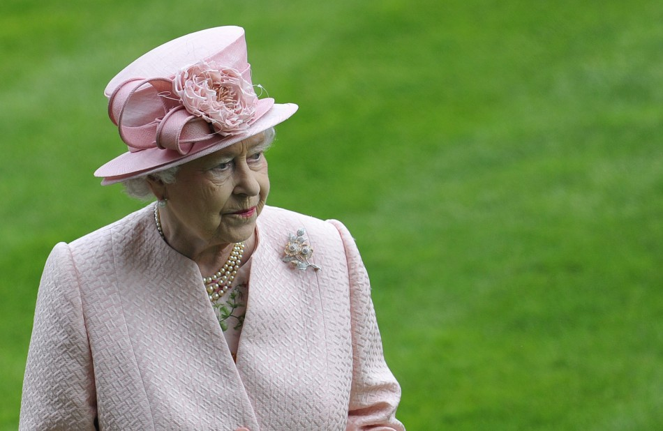 Britain's Queen Elizabeth observes a minute silence for Henry Cecil at Ascot race course in southern England June 18, 2013.