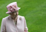 Britain\'s Queen Elizabeth observes a minute silence for Henry Cecil at Ascot race course in southern England June 18, 2013.