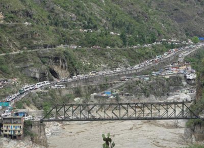 Stranded vehicles stand in queues after heavy rains in the Himalayan state of Uttarakhand June 17, 2013.