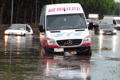 Cars and a delivery van are blocked on a street after a heavy thunderstorm with rain caused local flooding in Aulnay sous Bois near Paris, June 19, 2013.