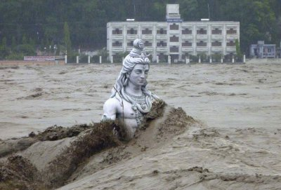 A submerged statue of the Hindu Lord Shiva stands amid the flooded waters of river Ganges at Rishikesh in the Himalayan state of Uttarakhand June 17, 2013.