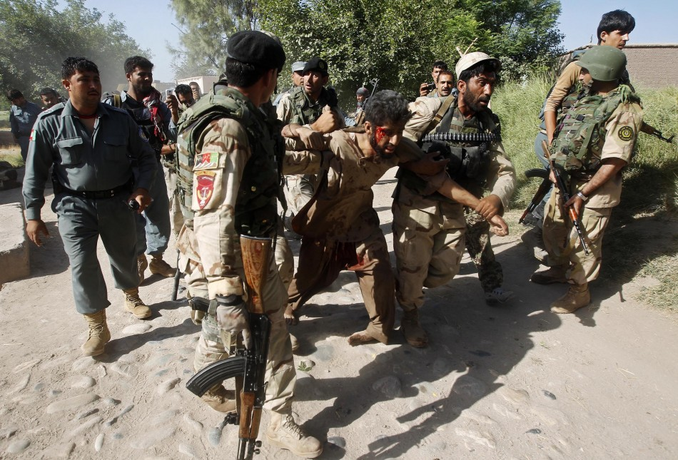 Afghan security forces with a captured suspected Taliban rebel