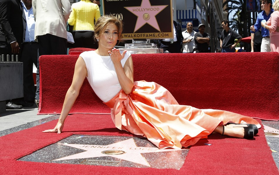 Singer and actress Jennifer Lopez blows a kiss at photographers as she poses on her star after it was unveiled on the Walk of Fame in Hollywood, California June 20, 2013.