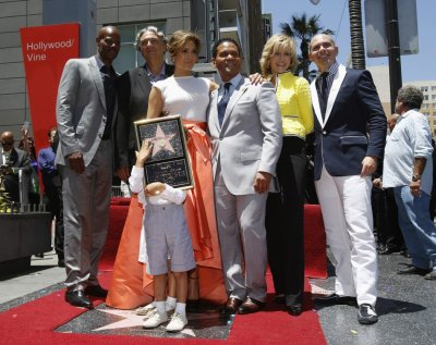 Lopez 3rd L poses with from L-R Keenen Ivory Wayans, Gregory Nava, her children Max and Emme, Benny Medina, Jane Fonda and Pitbull