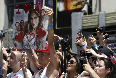Fans cheer during the ceremony for the unveiling of singer and actress Jennifer Lopezs star on the Walk of Fame in Hollywood, California June 20, 2013.