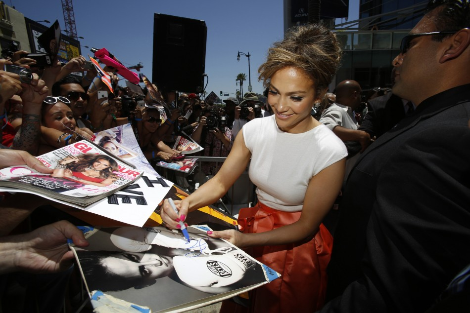 Lopez signs autographs after unveiling her star