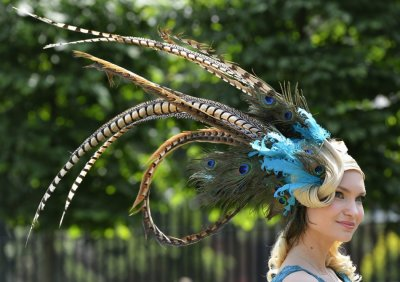 A racegoer arrives on the second day of the Royal Ascot