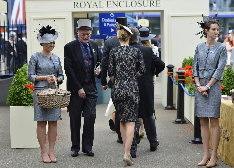 racegoers as they arrive at the Royal Enclosure for ladies day at the Royal Ascot horse racing festival at Ascot, southern England