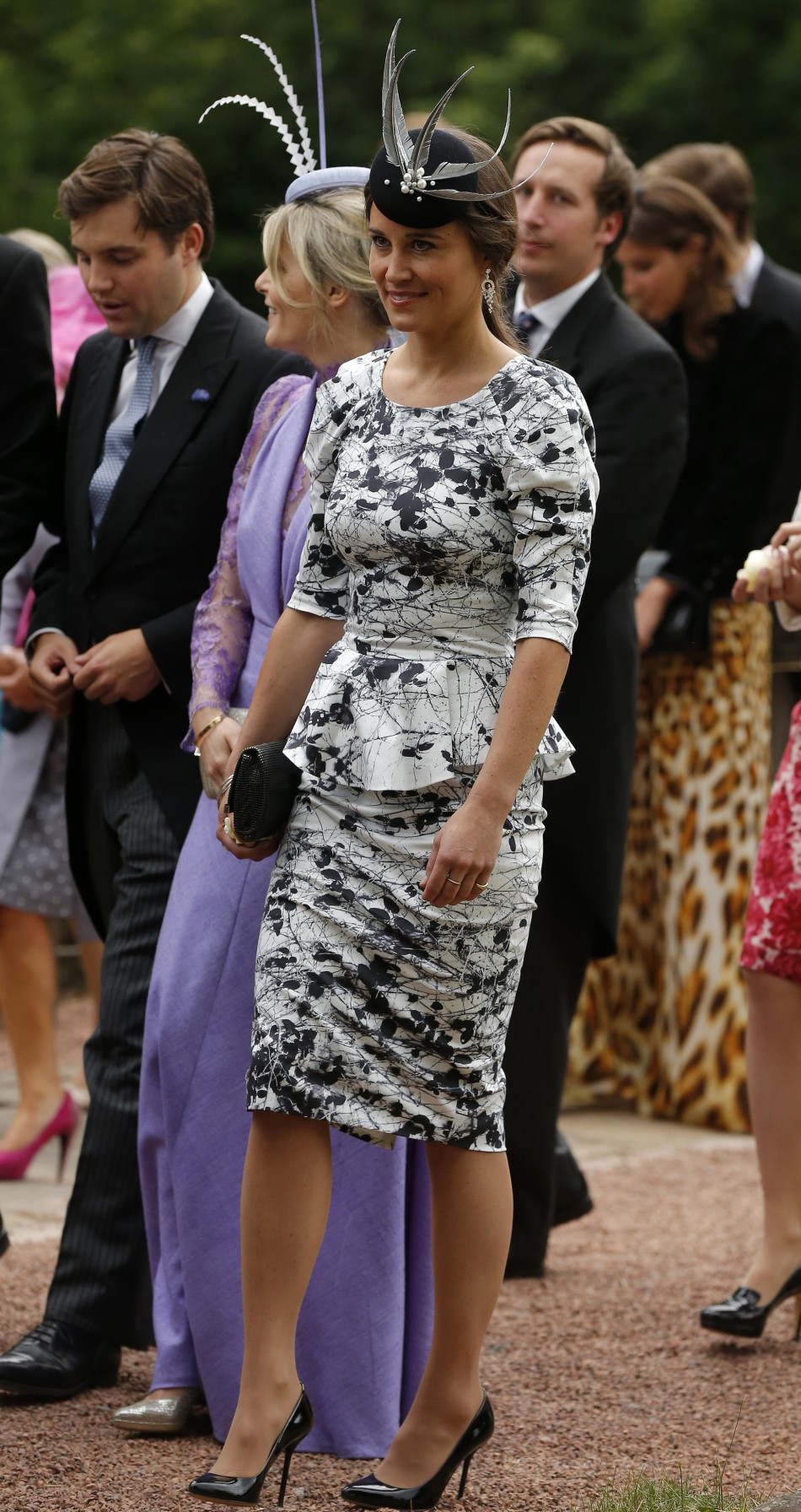 Pippa Middleton, the sister of Catherine, Duchess of Cambridge smiles as she leaves the wedding