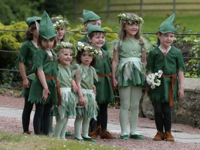Flower girls and page boys pose for a photograph