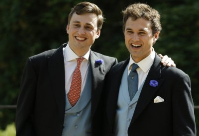 Groom Thomas van Straubenzee R smiles as he stands with his brother Charlie