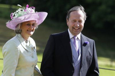 Alexander and Claire van Straubenzee smile as they arrive for the wedding of their son Thomas to Melissa Percy, daughter of Ralph and Jane Percy, the Duke and Duchess of Northumberland