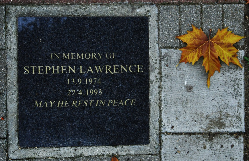 A plaque in memory of murder victim Stephen Lawrence, next to a bus stop in Eltham, south east London, where he was killed (Reuters)
