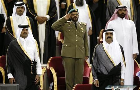 Qatar's Emir Sheikh Hamad bin Khalifa al-Thani (R) stands next to his son Crown Prince Sheikh Tamim bin Hamad al-Thani before the Emir Cup final match between Al-Sadd and Al-Rayyan at Khalifa stadium in Doha May 18, 2013.