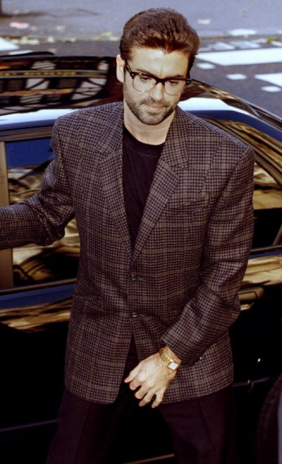 Singer George Michael arrives at the High Court for the second day of his bid to break from Sony Music Entertainment October 19.1993