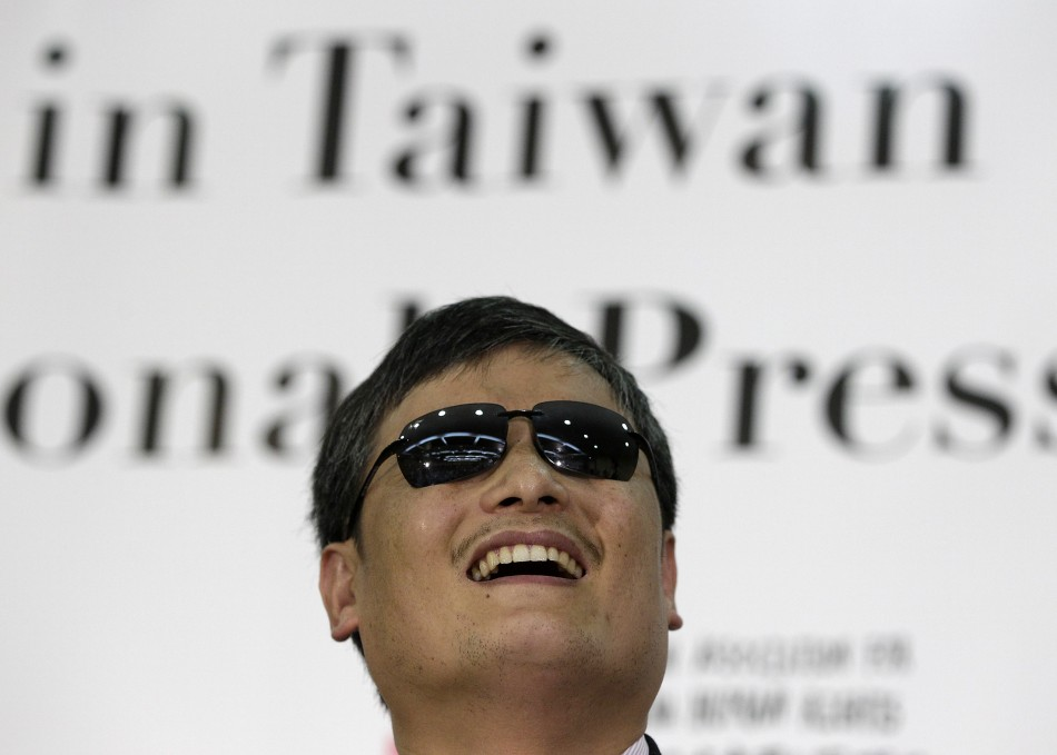 Chinese dissident Chen Guangcheng laughs during a news conference in Taipei