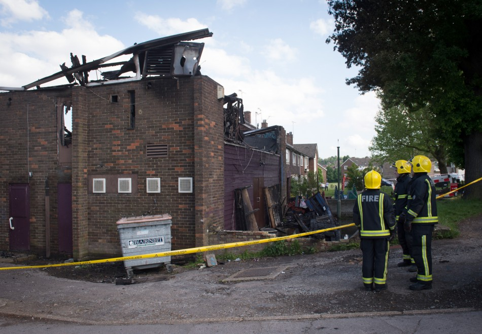 Firefighters stand at the firefighter walks past the Al-Rahma Islamic Centre in Muswell Hill (Reuters)