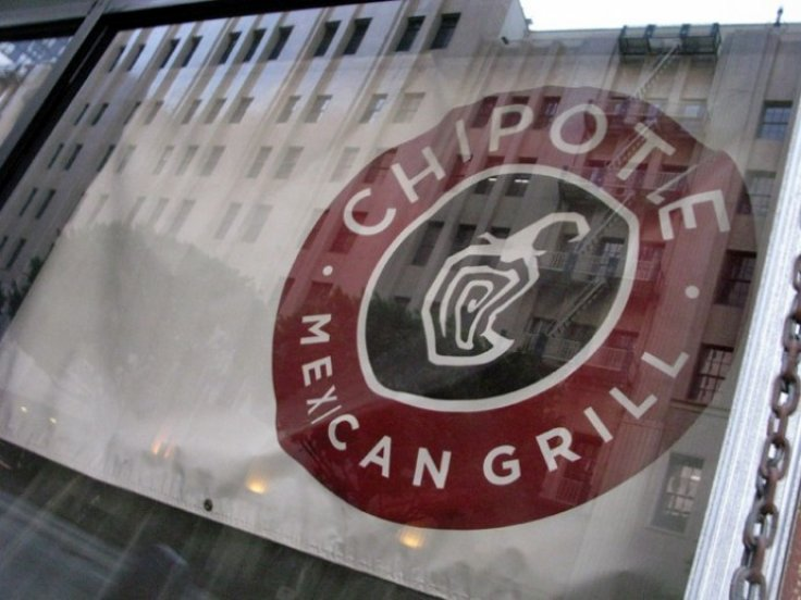 A Chipotle Mexican Grill sign hangs in a window of one of the chains restarants that is under construction in downtown Los Angeles