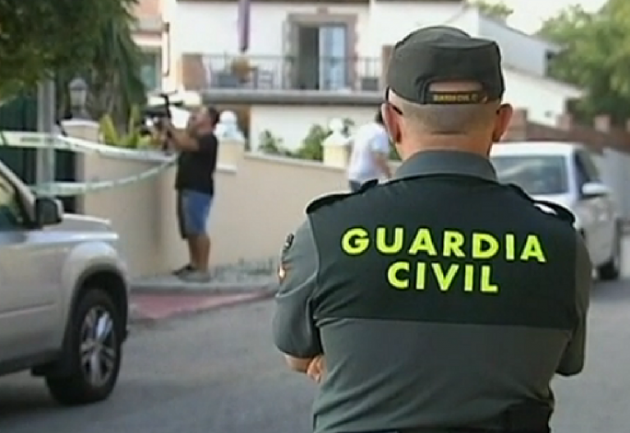 Police guard property at which three three people were found dead