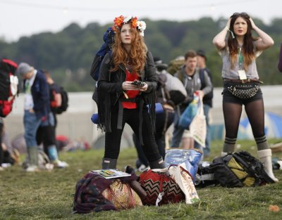 Festival goers arrive at the campsite