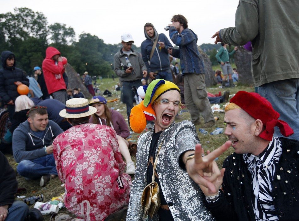 Festival-goers wait for sunrise at the stone circle