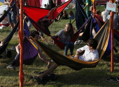 Festival goers relax in hammocks