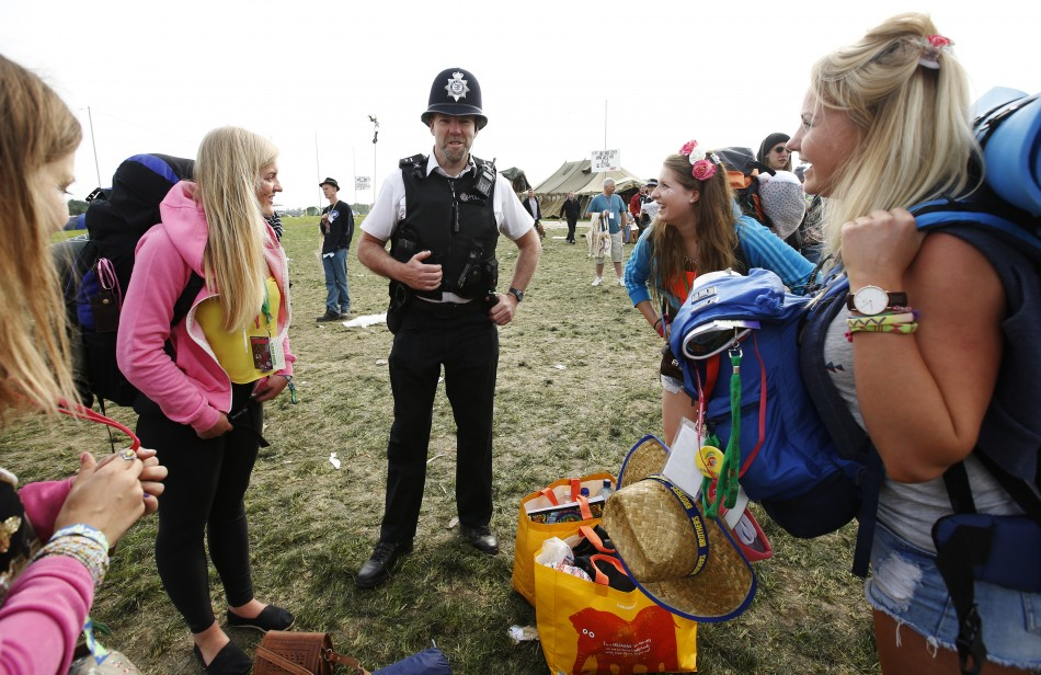 A policeman warns campers about recent thefts on site