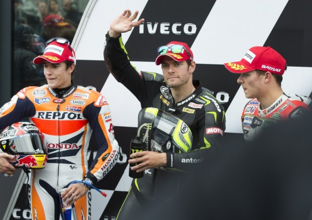 Crutchlow flanked by Marquez (L) and Bradl