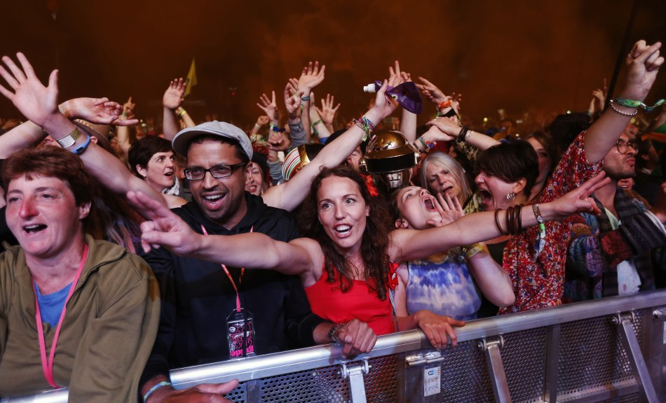 Festival goers cheer as Nile Rodgers and his band Chic perform on the third day of the Glastonbury music festival at Worthy Farm in Somerset June 28, 2013.