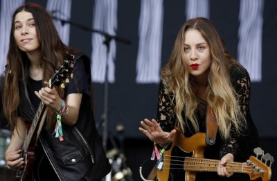 Danielle and Este Haim from all-sister Californian band Haim perform at the Pyramid stage during the Glastonbury music festival at Worthy Farm in Somerset, June 28, 2013.