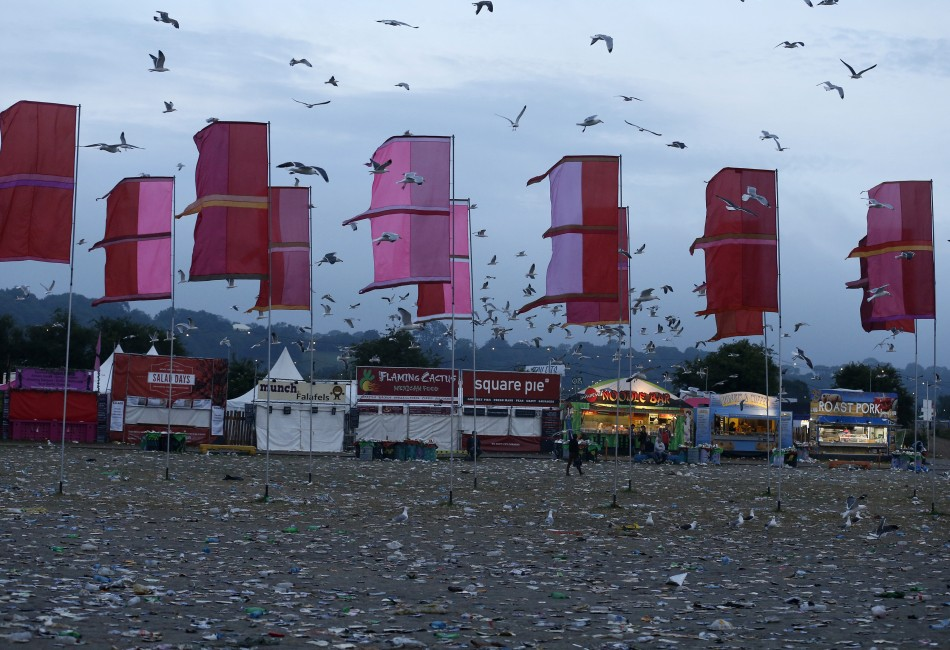 The field in front of the Other Stage is covered in litter at the Glastonbury music festival at Worthy Farm in Somerset, June 29, 2013.