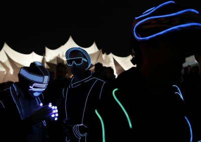 Gary Wright and Jon Williams wear light costumes in Shangri La field at Glastonbury music festival at Worthy Farm in Somerset, June 29, 2013.