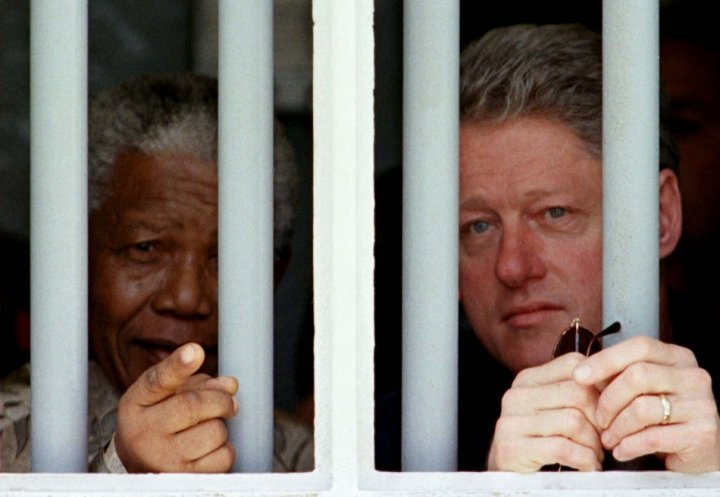 Mandela (l) in Robben Island cell with Bill Clinton