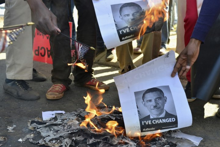 Protesters at University of Johannesburg burn images of Barak Obama