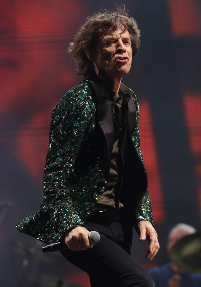 Mick Jagger of the Rolling Stones performs on the Pyramid Stage at Glastonbury music festival at Worthy Farm in Somerset, June 29, 2013.