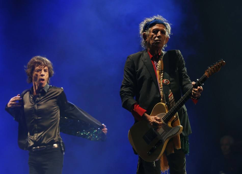 Mick Jagger L and Keith Richards of the Rolling Stones perform on the Pyramid Stage at Glastonbury music festival at Worthy Farm in Somerset, June 29, 2013.