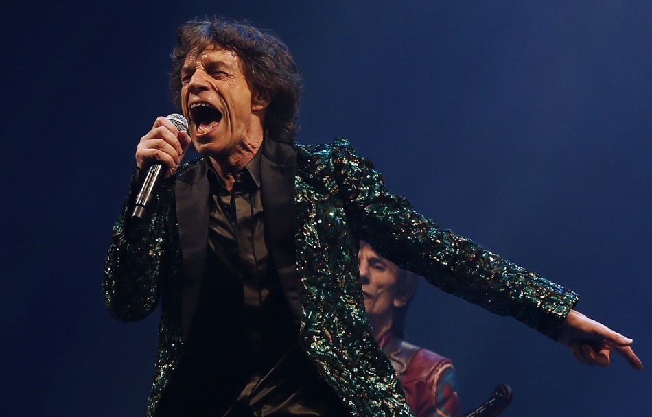 Lead singer of the Rolling Stones Mick Jagger performs on the Pyramid Stage at Glastonbury music festival at Worthy Farm in Somerset, June 29, 2013.