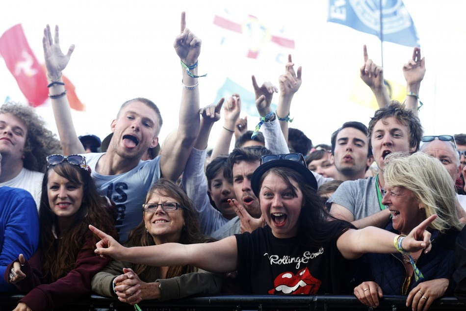 Festival goers watch Primal Scream perform on the Pyramid Stage at Glastonbury music festival at Worthy Farm in Somerset, June 29, 2013.