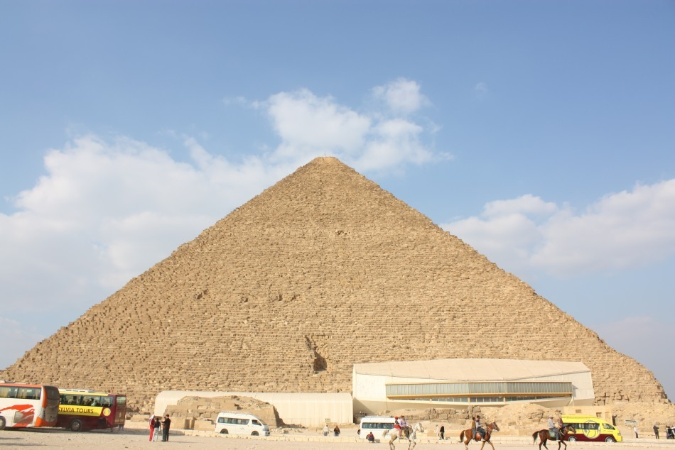 Great Pyramid of Giza from south showing the Solar boat museum (Wiki Commons)