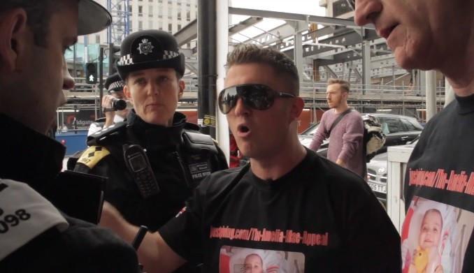Police halt Robinson in Aldgate in video