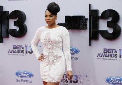Recording artist Ashanti arrives at the 2013 BET Awards in Los Angeles, California June 30, 2013.
