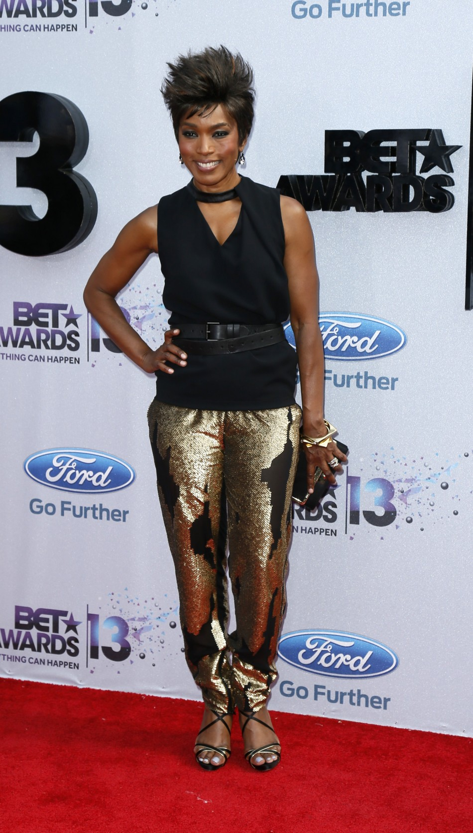 Actress Angela Bassett arrives at the 2013 BET Awards in Los Angeles, California June 30, 2013.