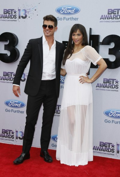 Singer Robin Thicke and his wife, actress Paula Patton, arrive at the 2013 BET Awards in Los Angeles, California June 30, 2013.