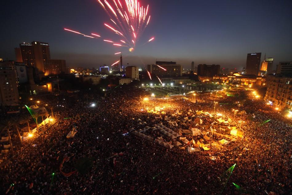 Protesters opposing Egyptian President Mohamed Mursi set off fireworks during a protest at Tahrir Square