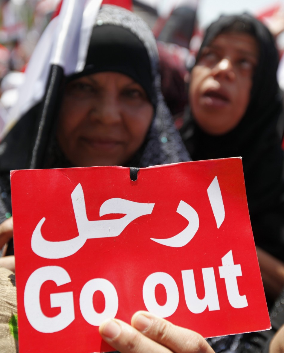 A protesters opposing Egyptian President Mohamed Mursi holds a sign during a protest at Tahrir square in Cairo