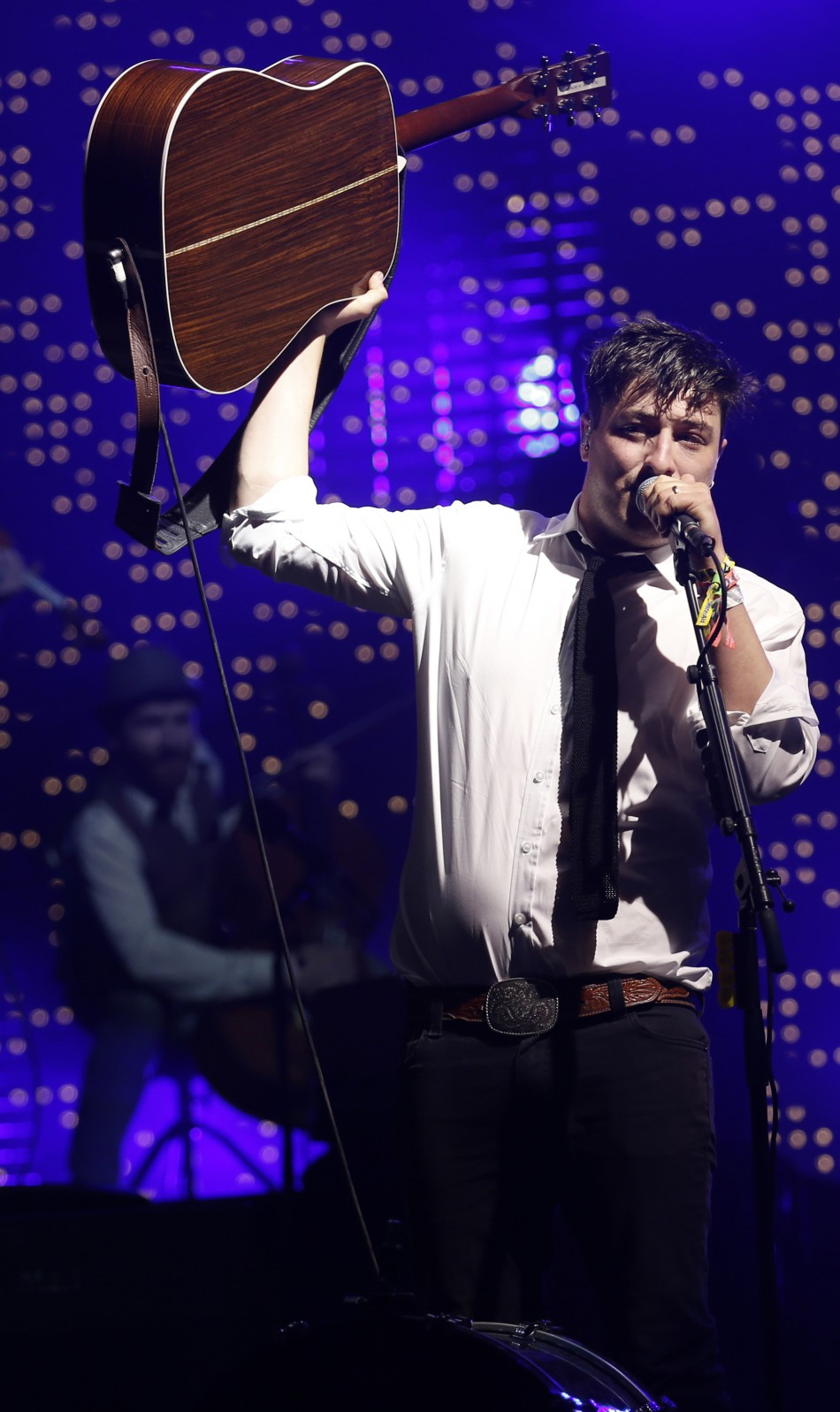 Marcus Mumford, lead singer of Mumford  Sons, performs on the Pyramid Stage at the Glastonbury music festival at Worthy Farm in Somerset, June 30, 2013.